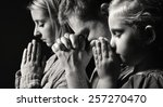 praying family. man  woman and... | Shutterstock . vector #257270470