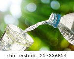 drinking water is poured from a ... | Shutterstock . vector #257336854