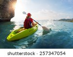 young lady paddling the kayak... | Shutterstock . vector #257347054