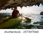 young lady paddling the kayak... | Shutterstock . vector #257347060