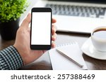 man holding a phone with... | Shutterstock . vector #257388469