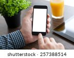 man holding a phone with... | Shutterstock . vector #257388514