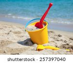 Yellow Sand Pail And Shovel On...