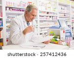 senior pharmacist reading... | Shutterstock . vector #257412436