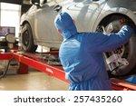serviceman worker checking car... | Shutterstock . vector #257435260