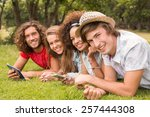 happy friends in the park on a... | Shutterstock . vector #257444308