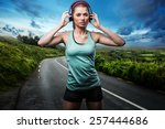 female runner with headphones | Shutterstock . vector #257444686