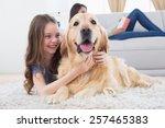 happy girl embracing golden... | Shutterstock . vector #257465383