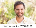 happy man smiling at camera on... | Shutterstock . vector #257482129