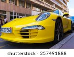 Постер, плакат: Parked bright yellow Porsche