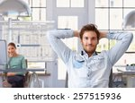 Stock photo young man taking break of work at trendy architect office 257515936
