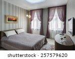 modern master bedroom interior... | Shutterstock . vector #257579620
