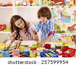 mother with kid  painting  in... | Shutterstock . vector #257599954