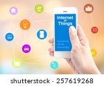 hand holding smart phone with... | Shutterstock . vector #257619268