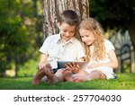 children with tablet pc... | Shutterstock . vector #257704030