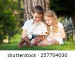 children with tablet pc... | Shutterstock . vector #257704030