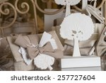 favors on a table outdoor with... | Shutterstock . vector #257727604