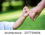 Stock photo happy grandfather and child have fun and play in park on beautiful sunny day 257734606