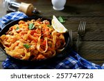 spaghetti with seafood in a pan ... | Shutterstock . vector #257747728