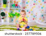 little cheerful child plays... | Shutterstock . vector #257789506