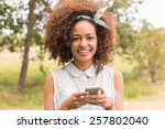 Happy Young Woman Using...