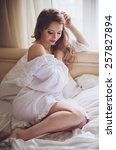 beautiful young woman in white... | Shutterstock . vector #257827894