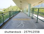 Walkway With A Metal Handrail.