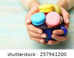 cup of tasty colorful macaroons ... | Shutterstock . vector #257961200