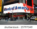NEW YORK - FEB 27: Pedestrians walk past a Bank of America sign in Times Square on February 27, 2009 in New York City. The bank is rumored to be next in line for government infusion of equity. - stock photo