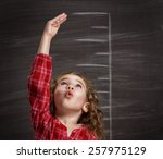 beauty child at the blackboard | Shutterstock . vector #257975129