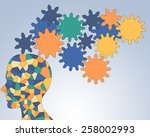Stock photo gears rotate inside the brain power of teamwork 258002993