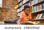 Cute Little Boy Reading Book I...