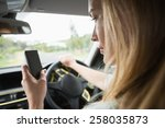 young woman using the phone in... | Shutterstock . vector #258035873