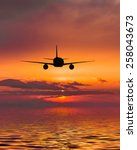 the plane flies over the sea at ... | Shutterstock . vector #258043673