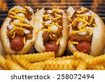 Three Hot Dogs With Mustard ...