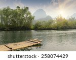 bamboo rafting on river ... | Shutterstock . vector #258074429
