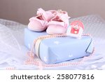 pink baby boots with gift close ... | Shutterstock . vector #258077816