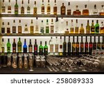 Stock photo backlit bottles and glassware behind a bar also known as the back bar 258089333