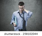 confused untidy businessman... | Shutterstock . vector #258102044