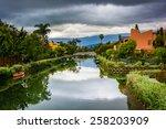 Houses And Bridge Along A Cana...