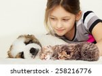 Stock photo child and a kitten and puppy 258216776