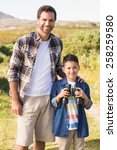 father and son on a hike... | Shutterstock . vector #258259580