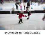 motion blurred child skating... | Shutterstock . vector #258303668