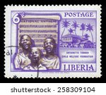 Small photo of LIBERIA - CIRCA 1957: a stamp printed in the Liberia shows children sing the national anthem, founding of the Antoinette Tubman child welfare foundation, circa 1957