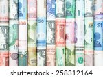 Stock photo a backgrounds with colorful of many roll currecy from many country 258312164