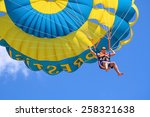Happy Man Flying Parasailing