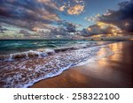 waves cresting onto a sandy... | Shutterstock . vector #258322100