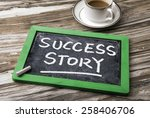 Small photo of success story handwritten on blackboard
