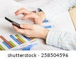 businesswoman hands analyzing... | Shutterstock . vector #258504596
