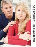 mature man comforting woman... | Shutterstock . vector #258526910